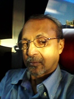 S ANANTHANARAYANAN holds an MSc in Physics and qualifications in IT, Public Admin and Law. He is also winner of an award from the Government of India for science communication. He is pictured here as he travels today (28 Oct 2014) on a coach from Oxford to Gatwick on his return journey to India via Copenhagen.